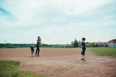 young-family-playing-softball